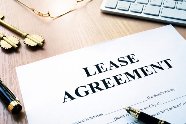 Rental lease agreement form on an office desk.