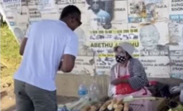 Duduzane Zuma buying food from the streets